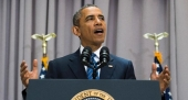 Obama urges tighter gun checks after Aurora
